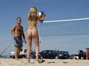 Some teen girl playing volleyball naked