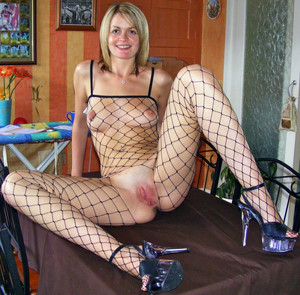 Cheerful leggy girlfriend in fishnet..